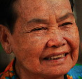 Closeup portrait of happy old woman — Stock Photo