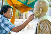Sculpture Tool. artisan creates the head of a Buddhist monk — Stock Photo