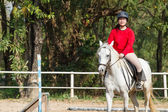 Woman riding horse — Stock Photo