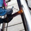 Stock Photo: Worker making sparks while welding steel