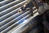 Industrial worker welding steel structure in factory,welding spa — Stock Photo