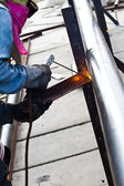 Worker making sparks while welding steel — 图库照片