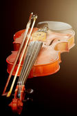 Close up of shiny violin on wooden table, isolated on black back — Stock Photo