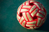 Plastic Sepak takraw ball on the cement floor. — Stock Photo