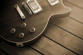 Vintage top guitar on old wood surface. — Stock Photo
