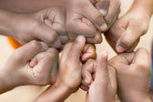 Hands of  family together closeup on autumn background — Stock Photo