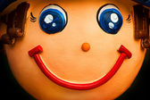 Face of smile baked clay doll, close up — Stock Photo