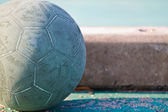 Old used football or soccer ball on cracked asphalt — Stock Photo