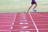 Cropped image of  runner on competitive running — 图库照片