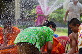 Water pouring to hands monk in Songkran festival on april 13,201 — Stock Photo