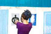 Target practicing with gun In the shooting range — Stock Photo