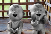 Two statuettes of funny boy and girl  — Foto Stock