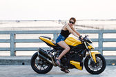 Biker girl sits on motorcycle — Stok fotoğraf