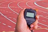 Close-up of  man holding  stopwatch to measure performances of t — Stock Photo
