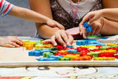 Hand child playing with construction blocks — Stock Photo
