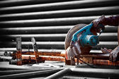 Cutting steel with machine for cutting steel by worker — Stock Photo