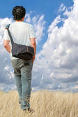 Young man walking alone — Stock Photo