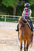 Child trains horse riding , — Foto Stock