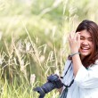 Attractive young woman talking pictures outdoors — Stock Photo #49551591