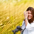 Attractive young woman talking pictures outdoors — Stock Photo #49551705
