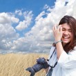 Attractive young woman talking pictures outdoors — Stock Photo #49551729