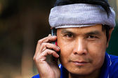 Portrait of mature man talking on phone — Stock Photo
