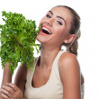 Close-up portrait of happy young woman with bundle herbs (salat — Stock Photo #13695224