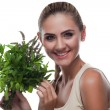 Happy young woman with a bundle of fresh mint. Concept vegetaria - Stock Photo