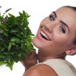 Happy young woman with a bundle of fresh mint. Concept vegetaria — Stock Photo #14078927