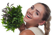 Happy young woman with a bundle of fresh mint. Concept vegetaria — Stock Photo