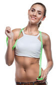 Woman in perfect shape with green measure doing yoga poses. C — Stock Photo