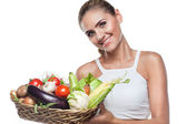 Woman holding basket with vegetable. Concept vegetarian dieting — Stock Photo
