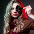 Stock Photo: Portrait of beautiful woman with makeup brushes