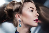Beautiful fashion model posing in exclusive jewelry. Profession — Stock Photo