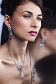 Fashion model posing in exclusive jewelry. Professional makeup — Stock Photo