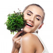 Portrait of happy young woman with a bundle of fresh mint — Stock Photo #23528893