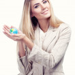 Pretty smiling woman holding a world globe. Business woman — Stock Photo