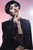 Sexy Fashionl Woman in Black Guipure Dress. Professional Makeup — Stock Photo