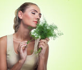 Close-up portrait of happy young woman with bundle herbs (dill) — 图库照片