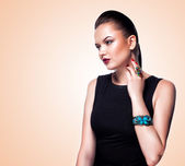 Glamour portrait of beautiful fashion model posing in exclusive jewelry — Stock Photo