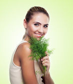 Woman with bundle herbs (salad). Concept vegetarian dieting — Stock Photo
