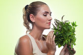 Woman with bundle herbs (mint). Concept vegetarian dieting — Stock Photo