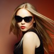 Fashion woman in sunglasses, studio shot. Professional makeup and hairstyle — Stock Photo #29958241