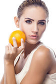 Happy young woman with orange — Stock Photo