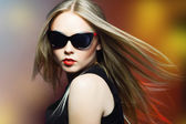 Fashion woman in sunglasses, studio shot. — Stock Photo