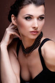 Woman in exclusive jewelry — Stock Photo