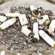 Stock Photo: Cigarettes and ashes in ashtray