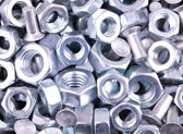 Nuts of bolts as a background — Stock Photo