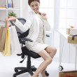 Businesswoman with shopping in the office — Stock Photo