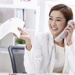 Businesswoman talking on the phone in the office — Stock Photo #13281175